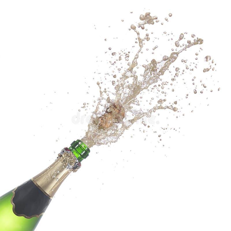 瓶香槟流行它的黄柏 免版税库存图片