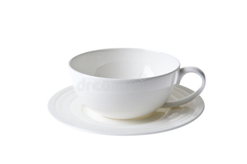 瓷杯子查出的porcelan sauser集合白色 库存图片