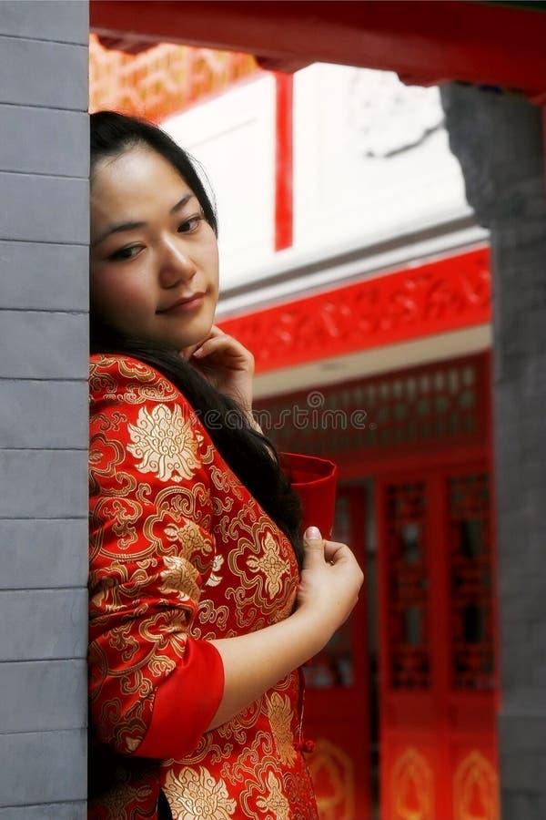 瓷衣物女孩红色 免版税库存图片