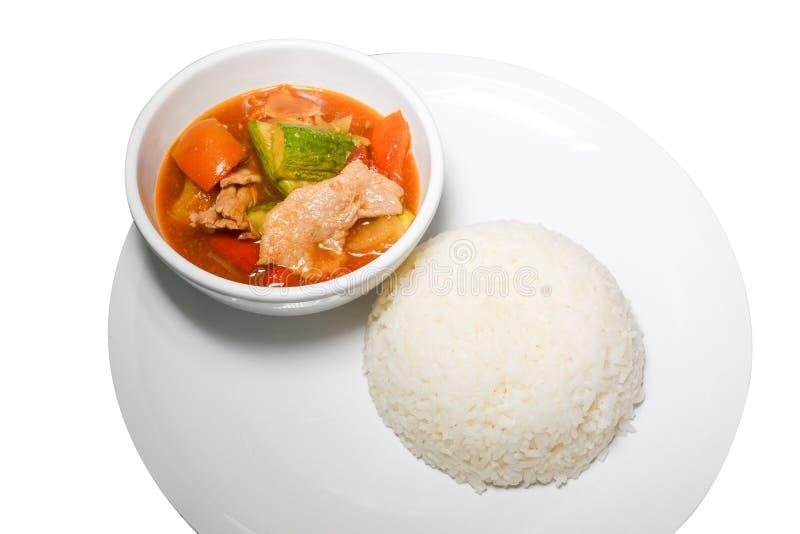 甜点和调味汁油煎了猪肉用在白色背景0169的米 免版税库存照片