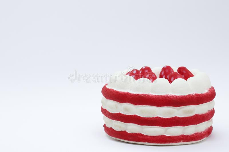 甜点心,与在照片的角落的红色和白色层数 E 免版税库存照片
