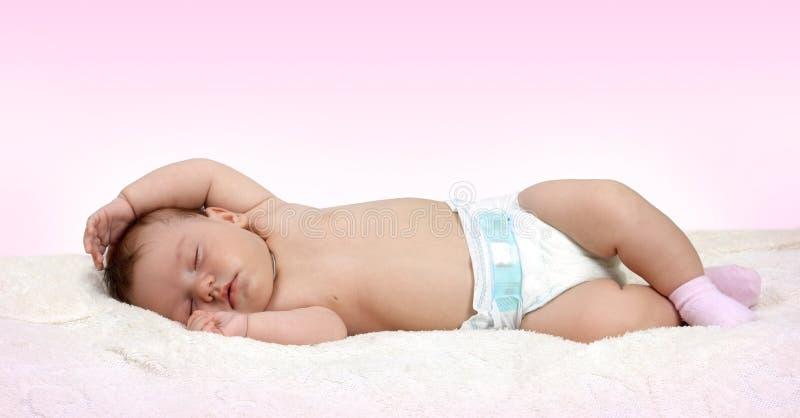 甜甜地休眠的婴孩 库存照片