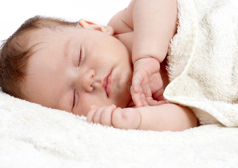 甜甜地休眠的婴孩 免版税库存图片