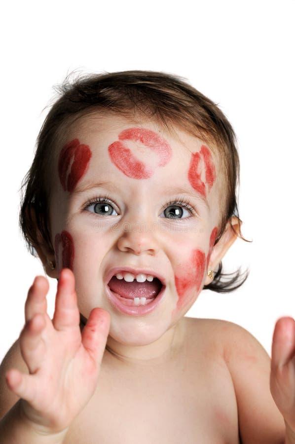 甜婴孩,有亲吻踪影的在他的面孔的 库存图片