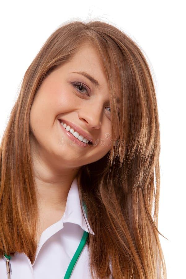 医生妇女与听诊器,医疗保健的微笑面孔 免版税库存照片