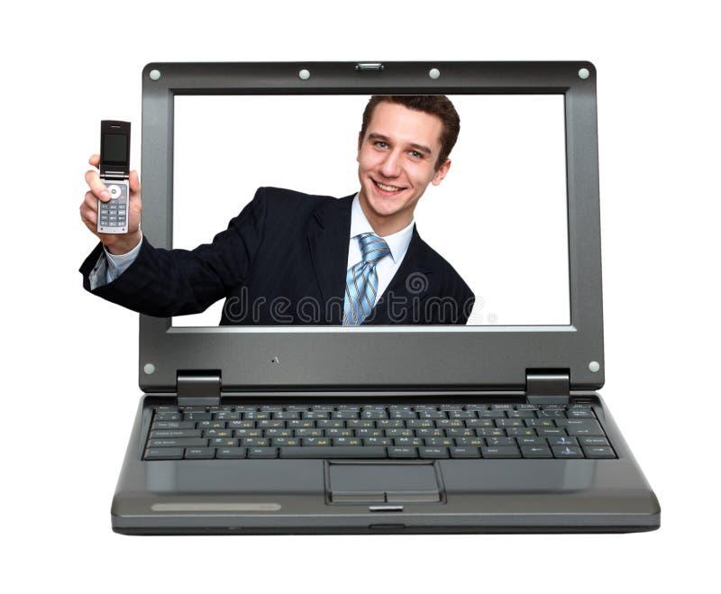 生意人产生您膝上型计算机的电话 图库摄影