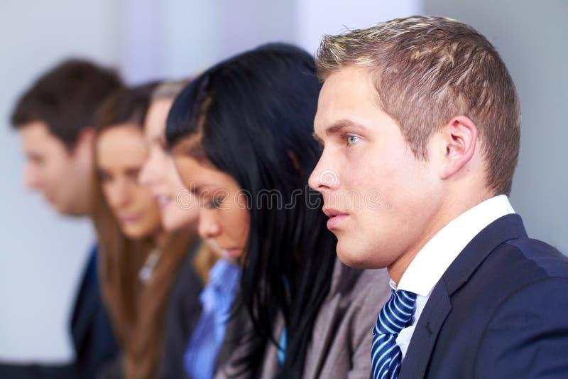 生意人他的小组年轻人 库存图片