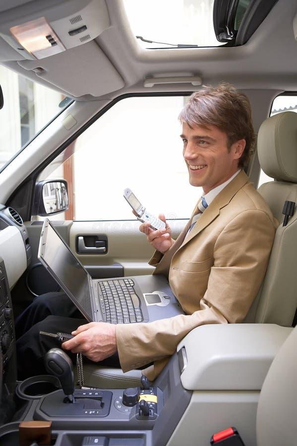 生意人他的材料微笑的无线世界 库存图片