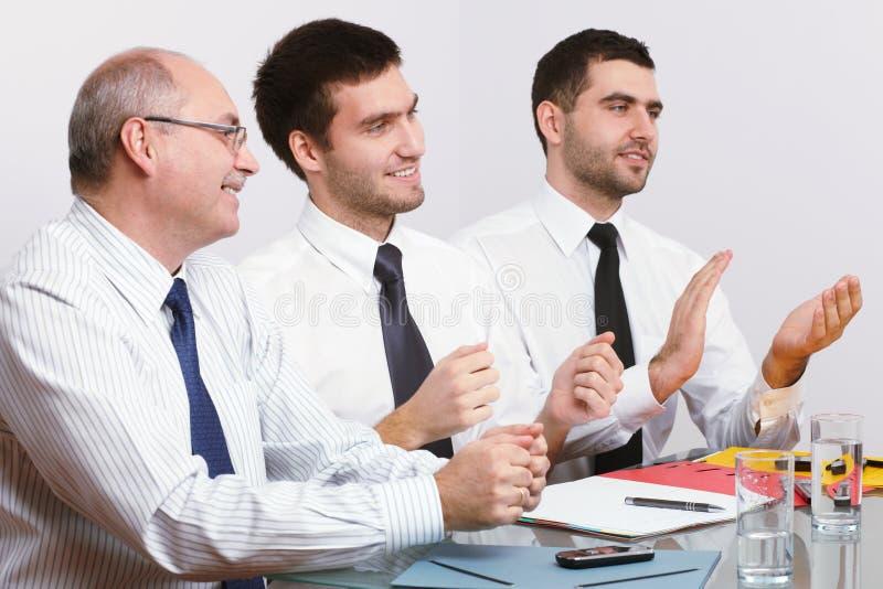 生意人会议坐的表三 图库摄影