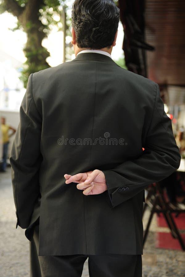 生意人克服的手指说谎者 免版税库存照片