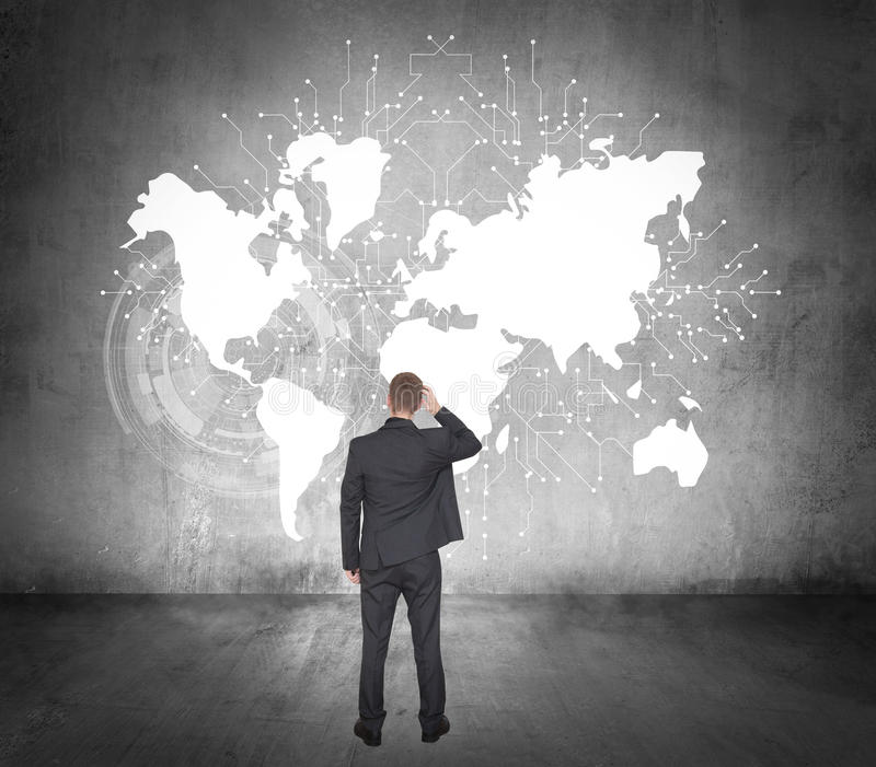 生意人前映射常设世界 免版税库存图片