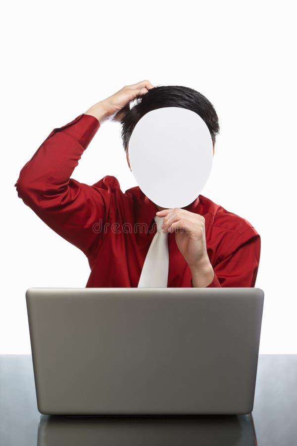 生意人匿名的膝上型计算机 免版税库存图片