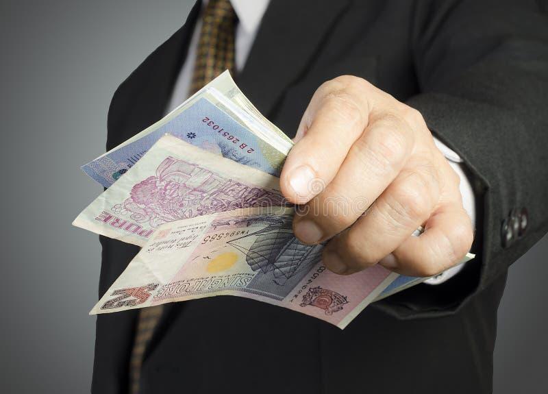生意人和货币 图库摄影