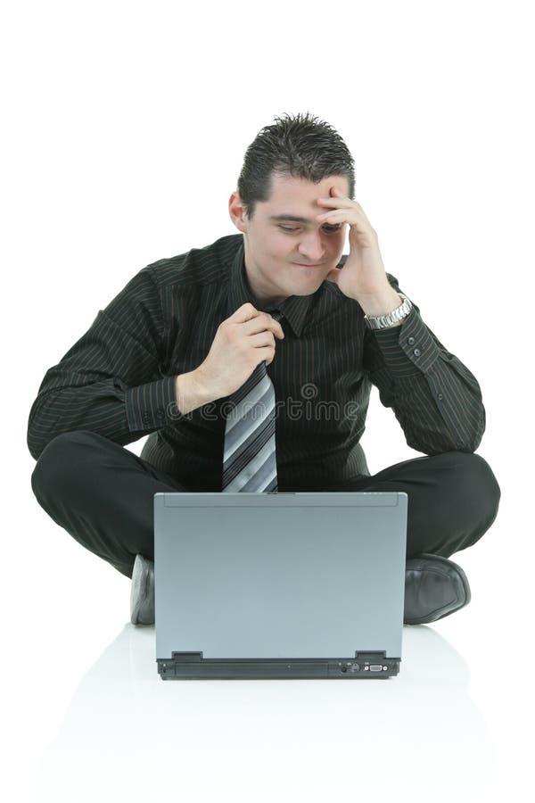 生意人失望的膝上型计算机 库存图片