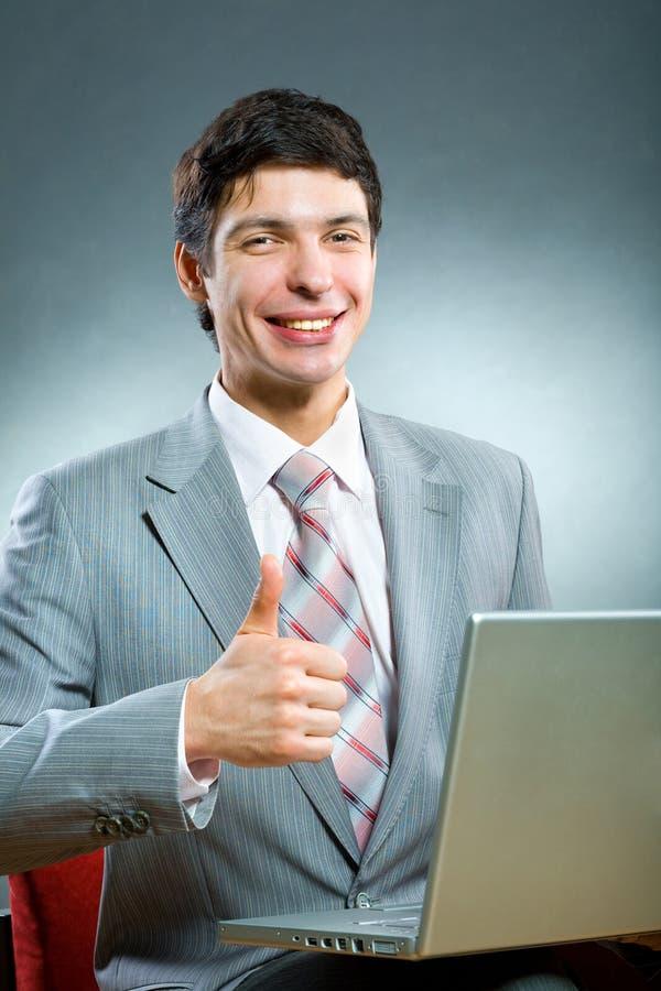 生意人微笑年轻人 库存照片