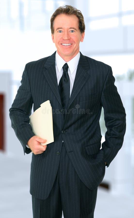 生意人文件夹现有量高级微笑 库存图片