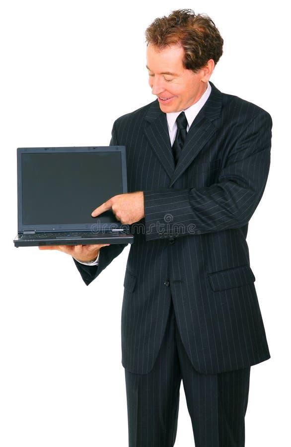 生意人查出膝上型计算机当前高级微&# 免版税库存图片