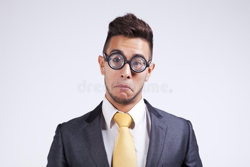 生意人滑稽的玻璃 库存照片