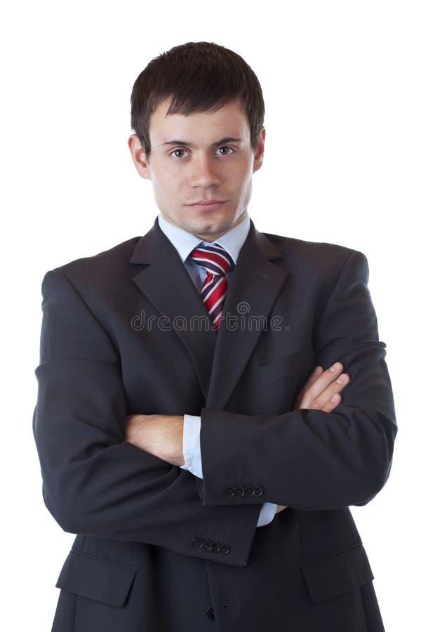 生意人照相机看起来严重的年轻人 免版税库存照片
