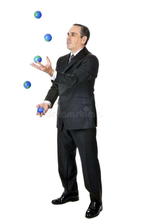 生意人玩杂耍 库存图片