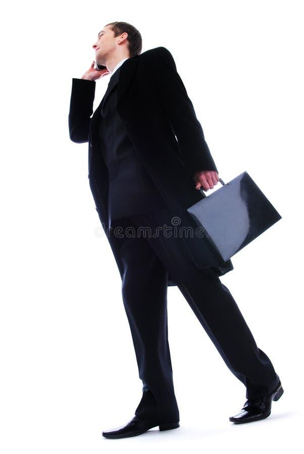 生意人电话联系的走 免版税库存图片