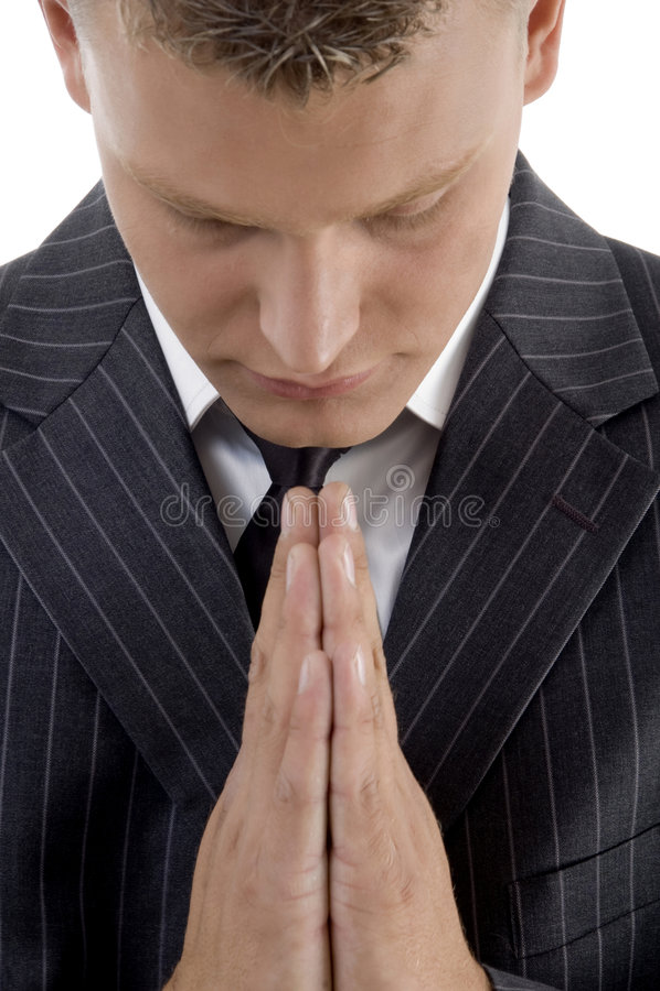 生意人祈祷的年轻人 库存照片