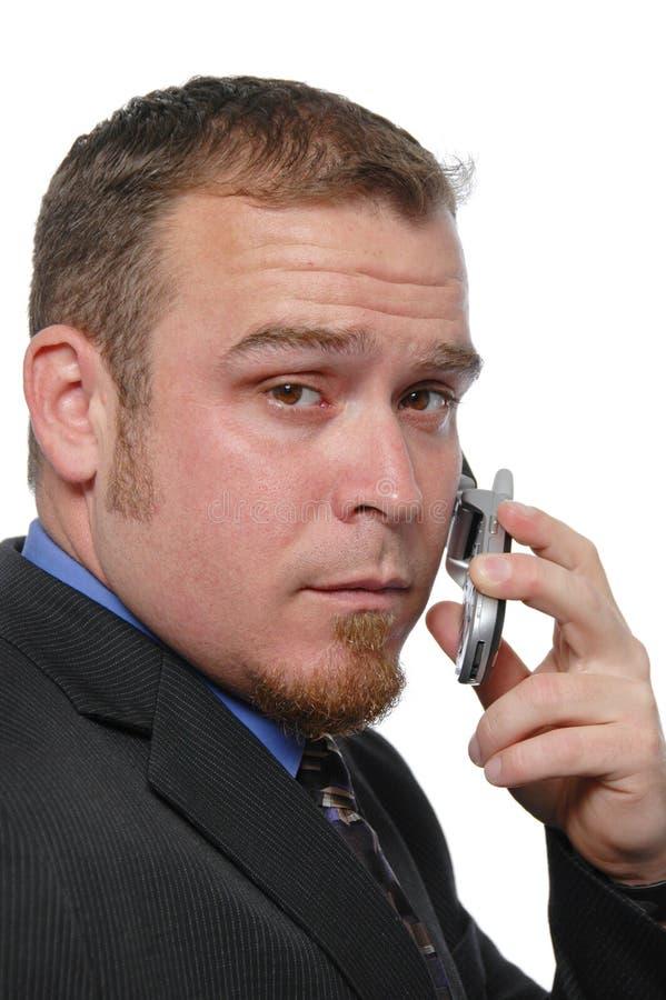 生意人移动电话 免版税库存图片