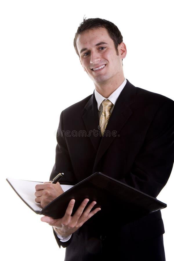 生意人笔记本诉讼文字年轻人 免版税库存图片