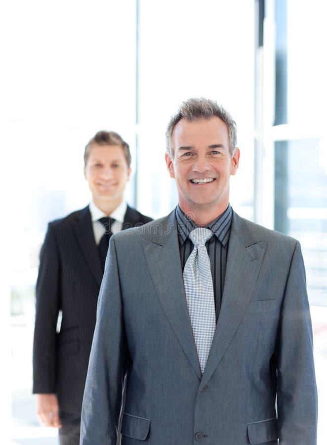 生意人纵向高级微笑 库存图片