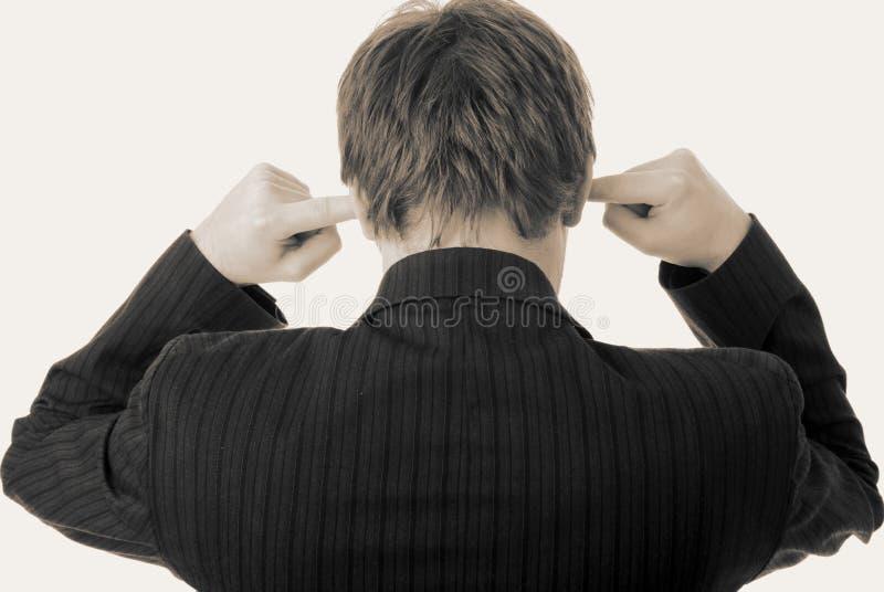 生意人耳朵手指听噪声 免版税库存图片