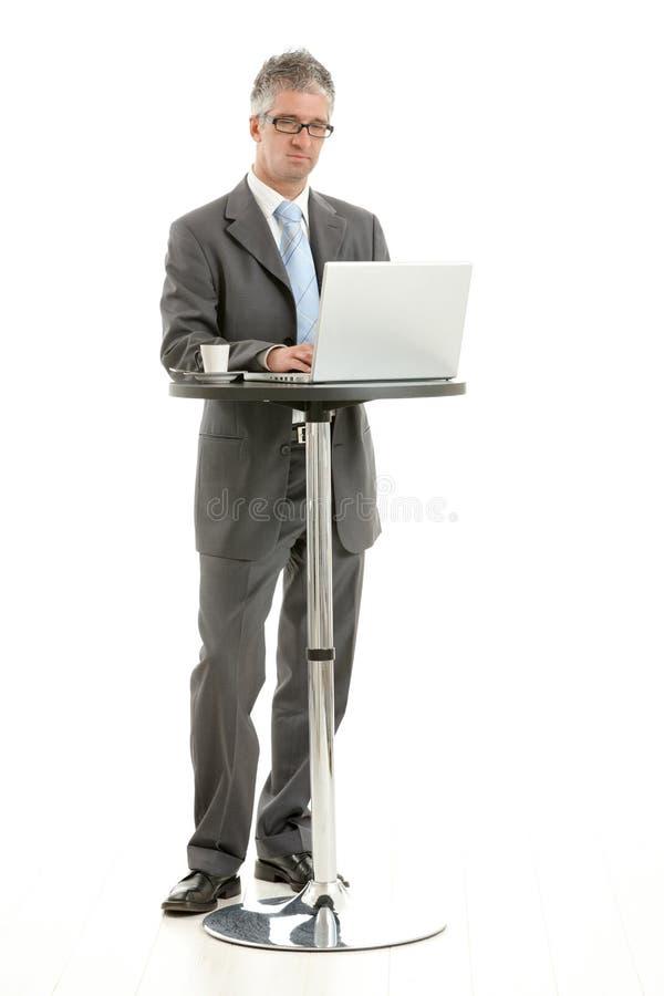 生意人膝上型计算机 免版税库存照片
