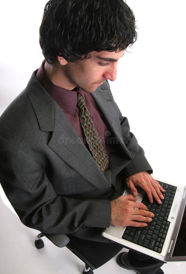 生意人膝上型计算机 库存照片