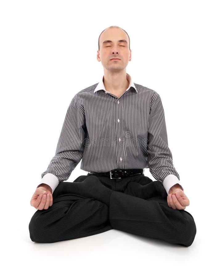 生意人莲花思考的瑜伽 免版税库存照片