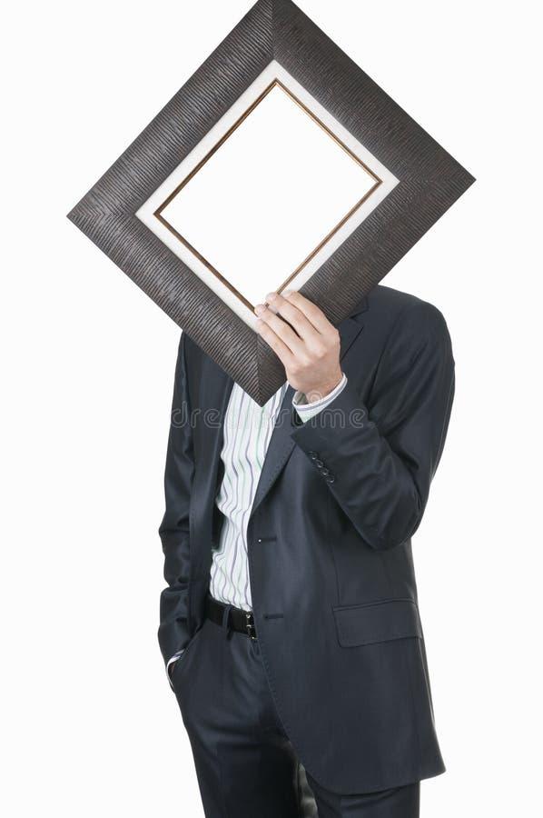 生意人藏品框架 库存图片