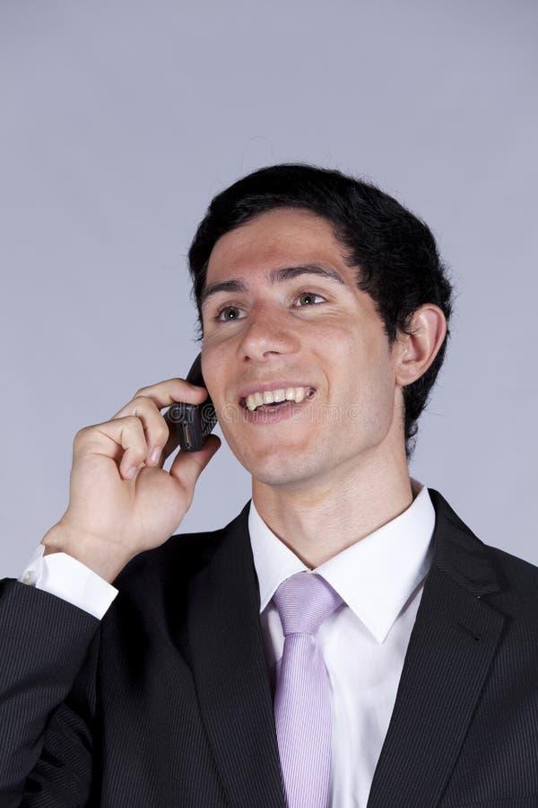 生意人蜂窝电话联系 免版税库存图片