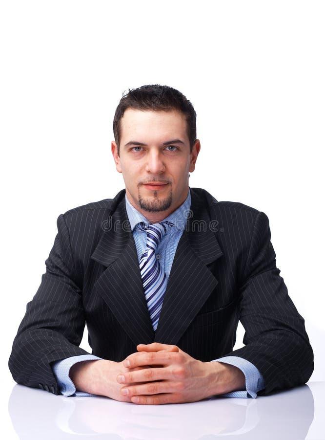 生意人被折叠的现有量坐 免版税库存照片