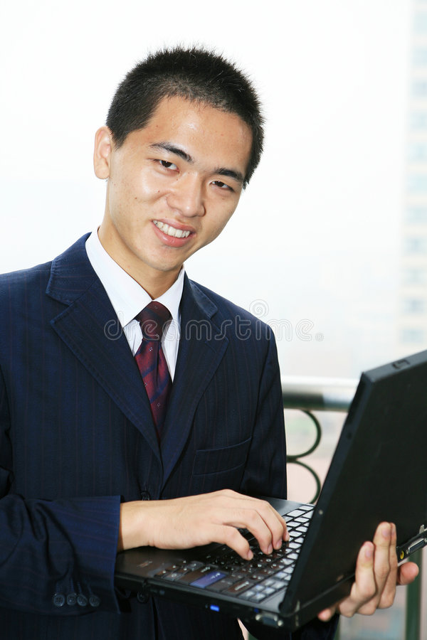 生意人计算机藏品膝上型计算机 免版税库存图片