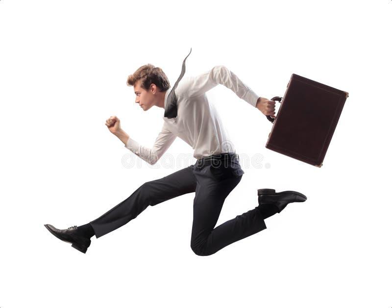 生意人跑跳步 免版税图库摄影