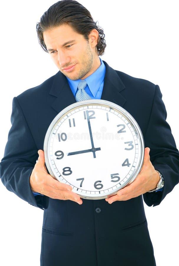 生意人难受时钟的藏品 免版税库存图片