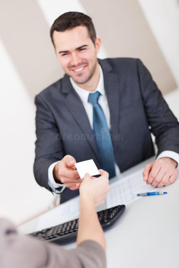 生意人面试年轻人 免版税库存照片