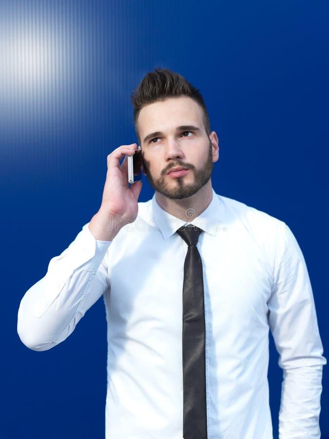 生意人移动电话使用 库存图片
