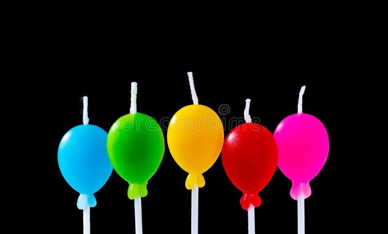 生日在黑背景隔绝的气球蜡烛 图库摄影