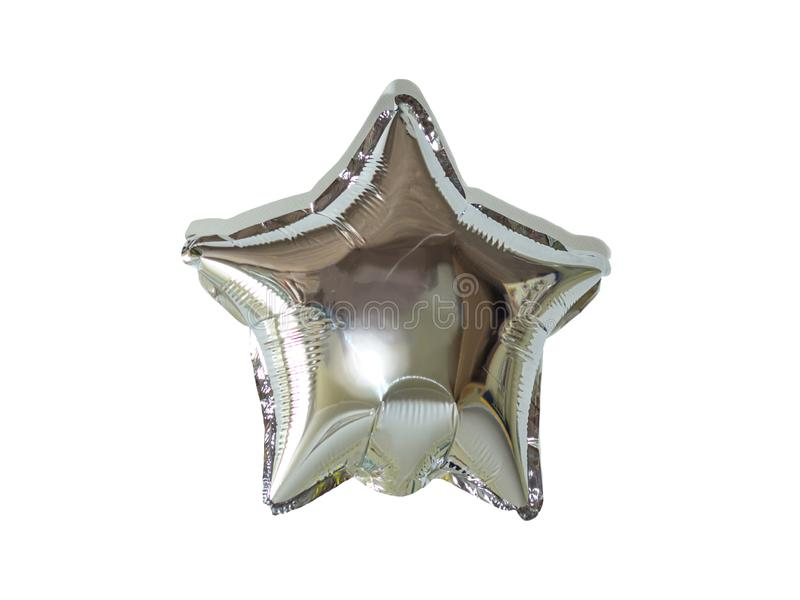 生日宴会的唯一银箔星气球对象 库存照片