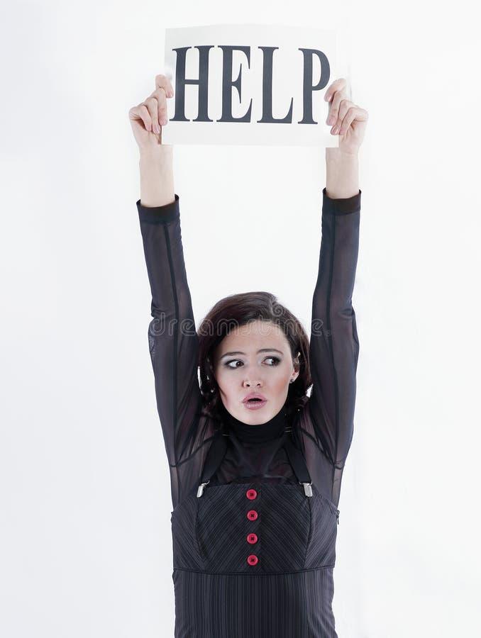 生气年轻女商人请求帮忙 免版税图库摄影
