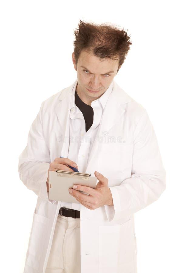 医生疯狂的头发垫和笔看头下来 库存照片