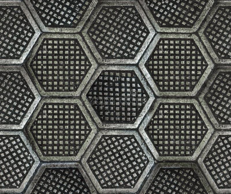 生铁六角工厂地板纹理 免版税库存图片