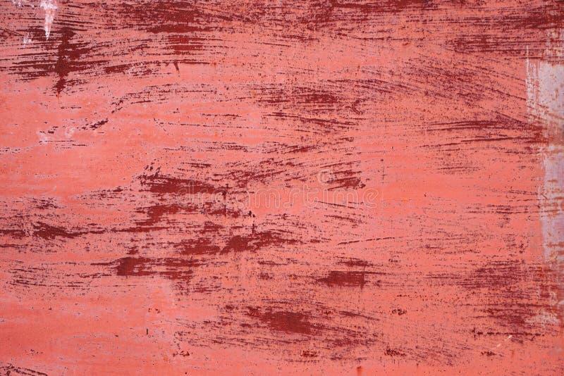 生锈的纹理 桃红色低劣的金属纹理 被抓的油漆 免版税图库摄影