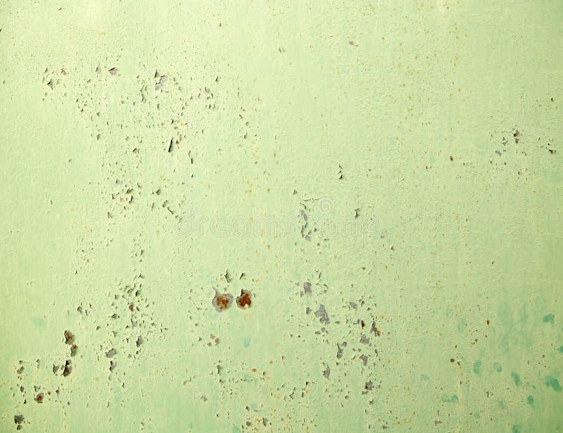 生锈的金属被绘的绿色油漆 库存图片