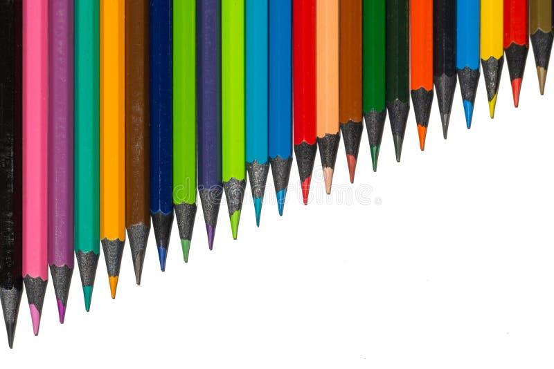 生长从乌木木头的套多彩多姿的pensils行 免版税库存照片