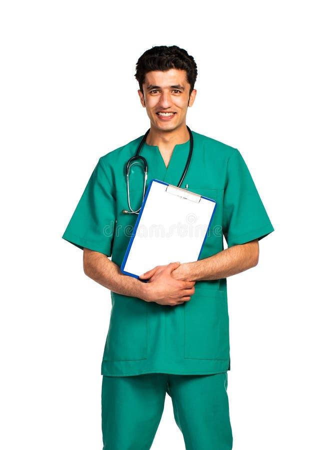 医生阿拉伯国籍画象与健康记录的在白色 库存图片